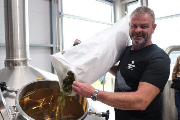 Simon pouring hops